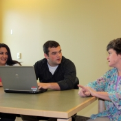 Accounting students Sarah Vest and Matthew McKirahan with client Teresa Harbett